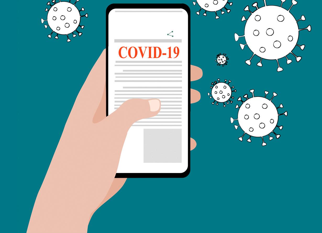 Ilustração em fundo azul com ícones do coronavírus e uma mão segurando um celular. Na tela do aparelho há o texto covid-19